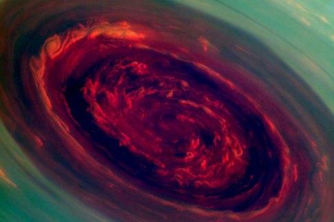 The Glowering Red Eye of Saturn's Hurricane, North Polar Vortex